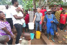 Celebrating water is flowing to one tap stand in Mekume with funders