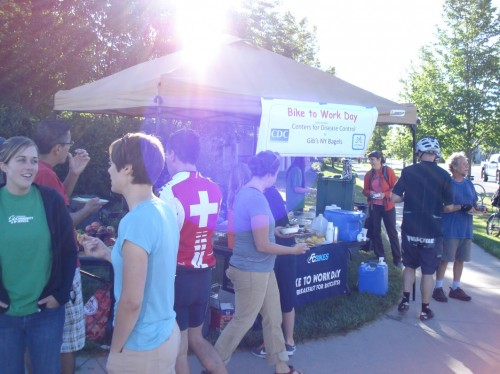 "The CDC is also an active member of our local community. Pictured above is ""Bike to Work Day."" Nearly fifteen other CDC campus members and I volunteered for the early morning event in June"