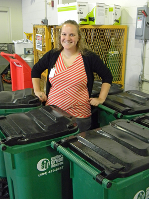 This is me in front of some composting bins. It's also important to note that this is not the first time I've posed in front of a waste receptacle.