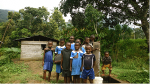 Children at stand tap near the Chief's compound in Ebasse. Some were too shy to smile for the picture!
