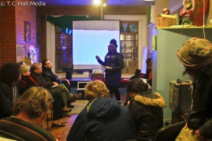 Dorthea Thomas educating audience about the roles of policy-making for environmental and climate justice.