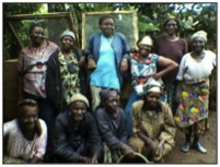 Rural female farmers posing after care-taking for their snail farms provided with the funding from FatPipe