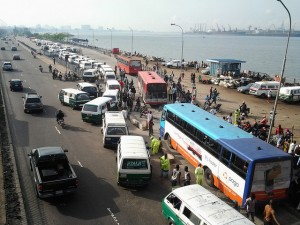 Traffic in Lagos, Nigeria with separate BRT lane. Photo Credit: Flickr/Bankole Oluwafemi.
